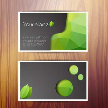 Vector business cards on wooden background - Free vector #131750